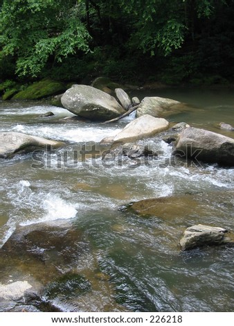Stream with large rocks - stock photo