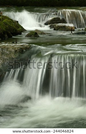 stream with litlle waterfall - stock photo