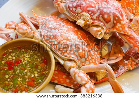 Streamed Crabs with sour and spicy sauce  - stock photo