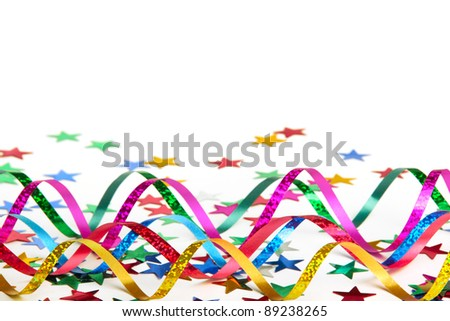 Streamer and confetti on white background - stock photo