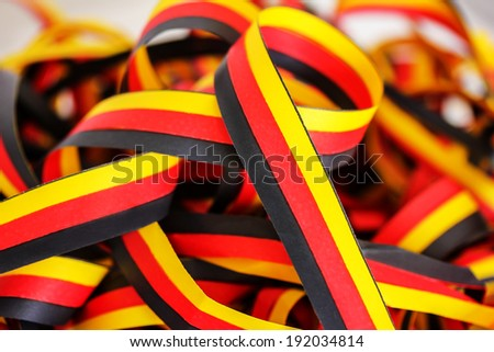 Streamers in black, red, yellow - stock photo