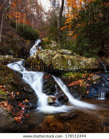 Streaming water and waterfall in fall colors, smoky mountains  - stock photo