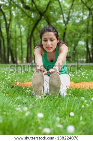 Streching in the Park - stock photo