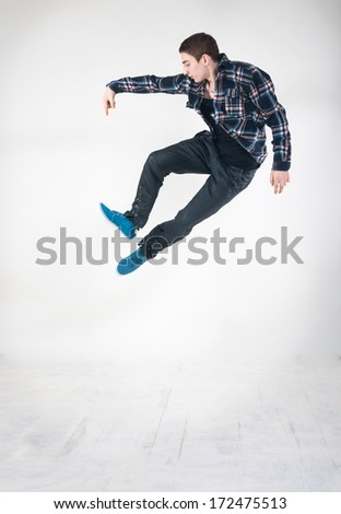 Street and hip-hop dancer on white background