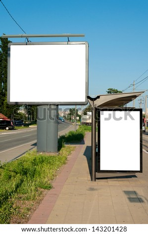 Street and the buss station blank billboards - stock photo
