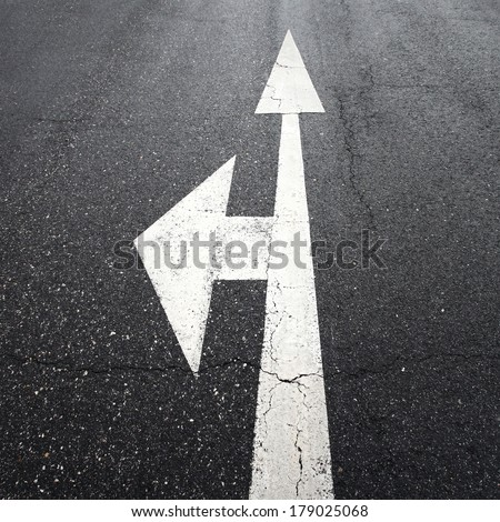 Street arrow signs on intersection choice. - stock photo
