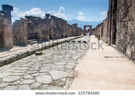 Street at ruins of ancient city Pompeii, destroyed by volcanic eruption of Vesuvio mountain, Italy - stock photo