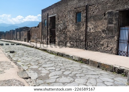 Street at ruins of ancient city Pompeii, destroyed by vulcanic eruption of Vesuvio mountain, Italy