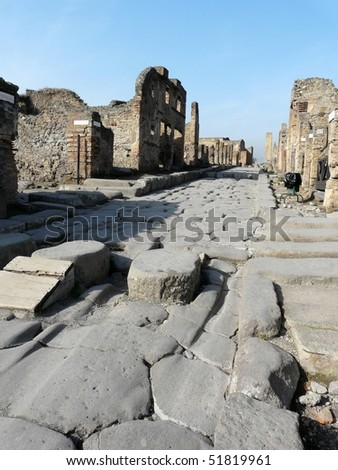 Street at the ancient Roman city of Pompeii, which was destroyed and buried by ash during the eruption of Mount Vesuvius in 79 AD - stock photo