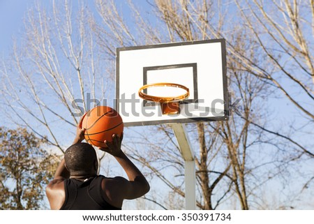 Street basket player playing outdoors