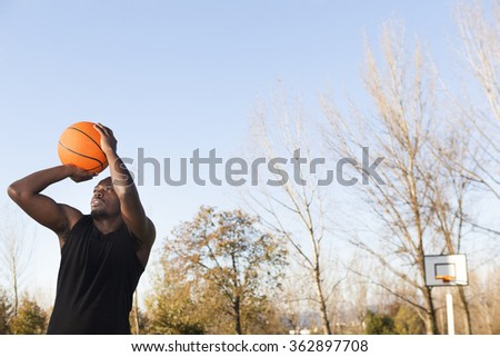 Street basket player playing outdoors - stock photo