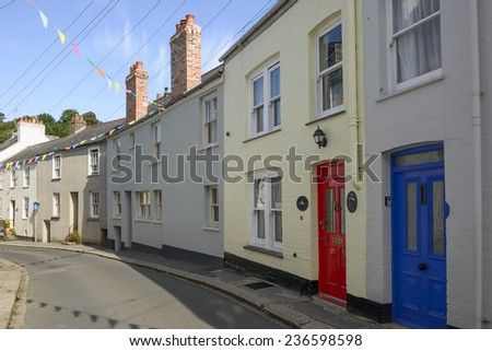 street bends at Fowey, Cornwall, view of bending street with old houses in the village on southern coast of Cornwall  - stock photo