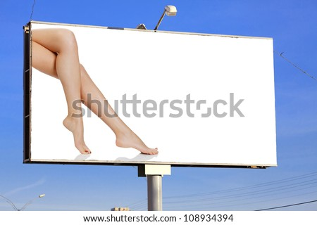 Street billboard with female legs and place for your message