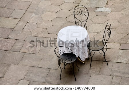 street caf���© round table and three chairs - stock photo