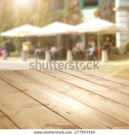 street cafe and wooden desk board place  - stock photo