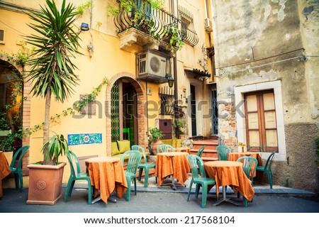 street cafe in the beautiful town Taormina, Sicily, Italy - stock photo