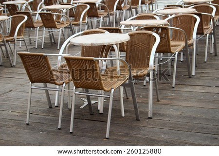 Street cafe tables and chairs, Italy - stock photo