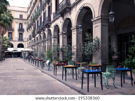 street cafe with colorful tables and chairs, in Europe - stock photo
