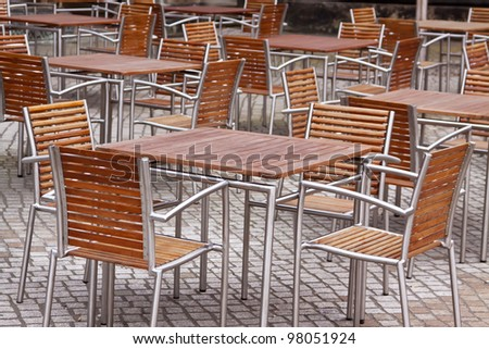 Street cafe with simple tables and chair