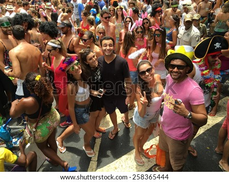 Street carnival parade in Rio de Janeiro, Brazil 2015 : Dancing crowd of happy people - stock photo