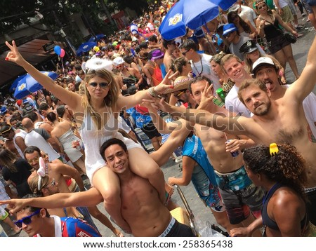 Street carnival parade in Rio de Janeiro, Brazil 2015 : Young people having party fun - stock photo