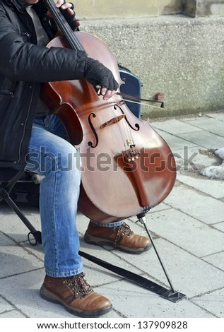 Street cellist - stock photo