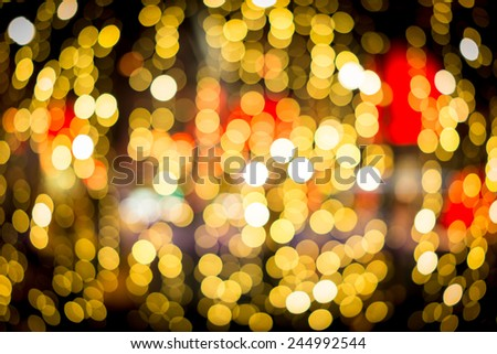 Street city night blurred lights in restaurants (abstract, out of focus) - stock photo