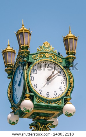 Street Clock against Blue Sky - stock photo