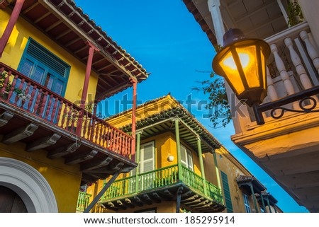 Street corner in Cartagena, Colombia where three old colonial balconies converge - stock photo