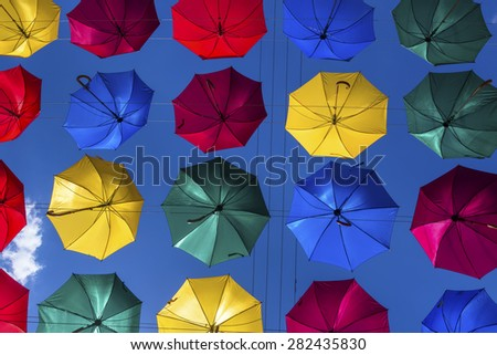 Street decorated with a lot of multicolored umbrellas in center of Saint Petersburg city, Russia  - stock photo