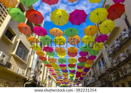 Street decorated with colored umbrellas.Petaling Jaya, Malaysia. - stock photo