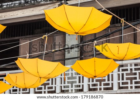 Street decorated with yellow umbrellas - stock photo