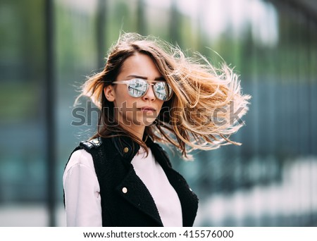 Street fashion concept. Young beautiful model in the city. Beautiful blonde woman wearing sunglasses close-up portrait of a young sexy girl hipster - stock photo