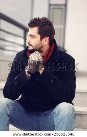 Street fashion, handsome brunet man outdoors - stock photo
