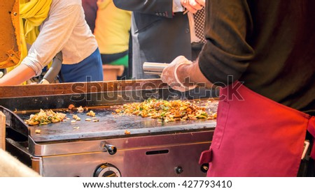 Street Food, Grilling Vegetables and Meat With Scrapers.  - stock photo