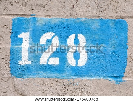 street house numbers.number 128 - stock photo