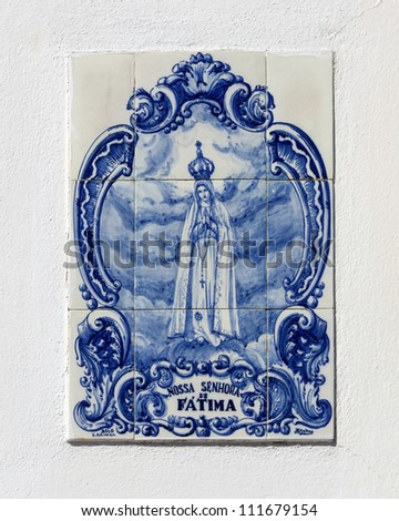 street icon ( Vintage azulejos  ) of the Mother of God in Fatima - Obidos, Portugal - stock photo