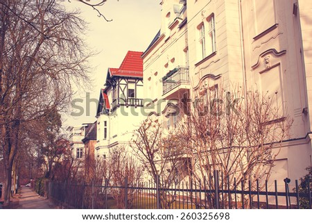 Street in Berlin with Historic Residential Houses with a retro vintage instagram filter effect - stock photo
