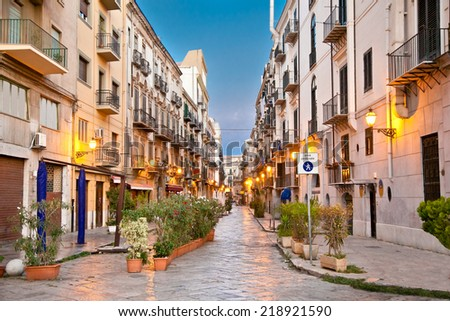 Street in La Kalsa or Mandamento Tribunali, the old Arab quarter of Palermo and one of the four historic centre in Palermo , Sicily. - stock photo