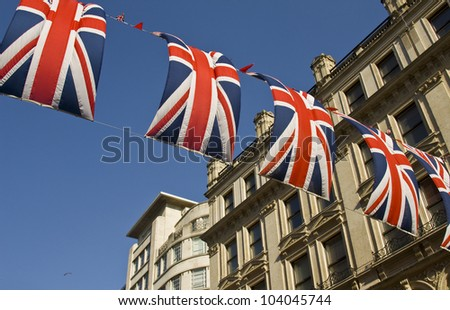 Street in London decorated with flags. May, 2012 - stock photo