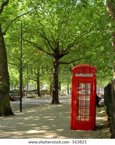 Street in Notting Hill area of London with telephone booth