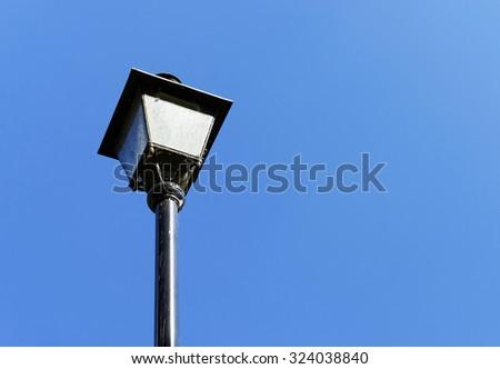 Street lamp against blue sky - stock photo