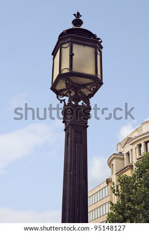Street lamp against the blue sky. Shot from London, England