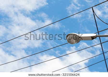 street lamp and cable on the blue sky