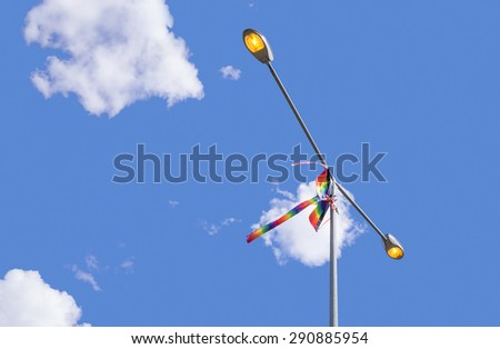 Street lamp and kite on blue sky background - stock photo