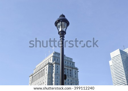 Street lamp and skyscrapers in Montreal downtown, Canada - stock photo