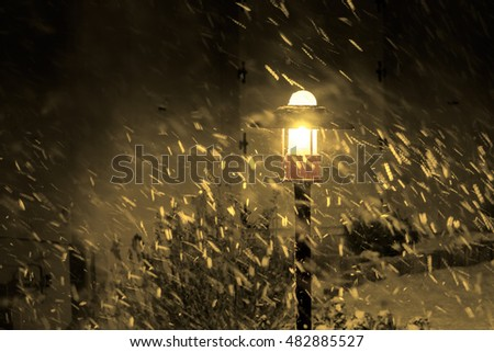 street lamp and snowy night