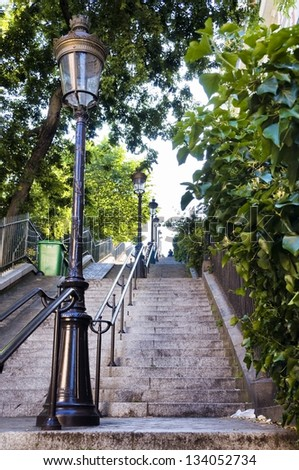 Street lamp and typical stairs in Montmartre (Paris, France) - stock photo