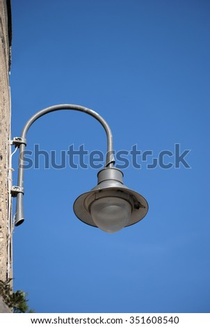 Street lamp ball  classic attacked wall