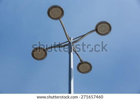 Street lamp on blue sky - stock photo